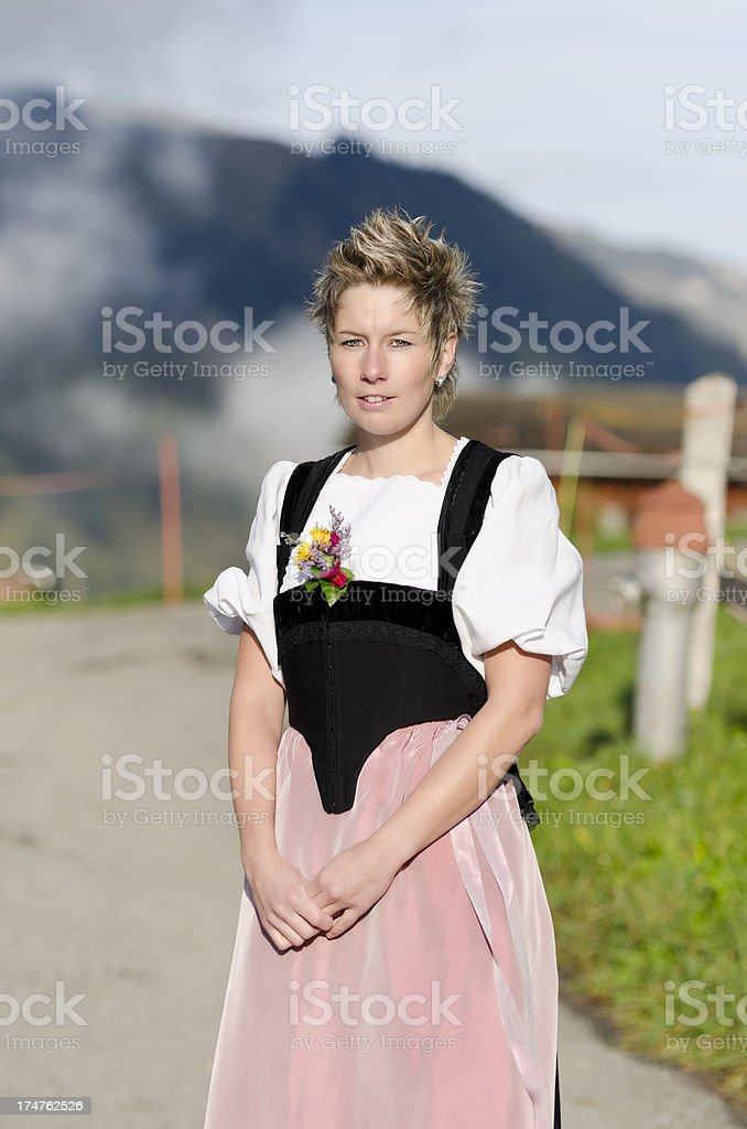 Young Swiss farmer woman portrait in traditional alpine dress stock photo