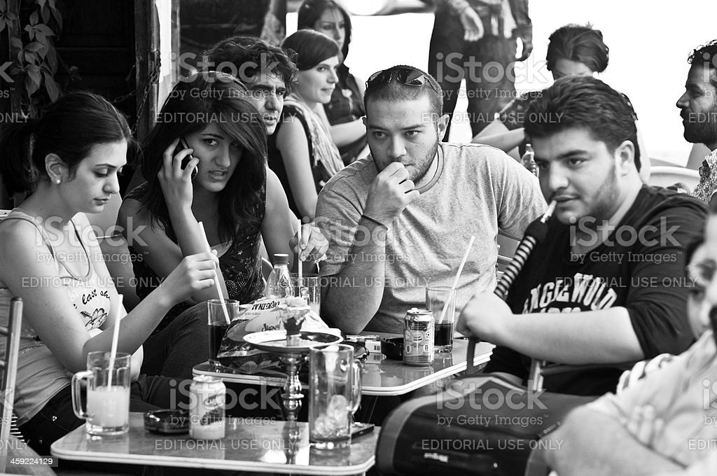 Young Syrian men and women in a cafe in Damascus stock photo