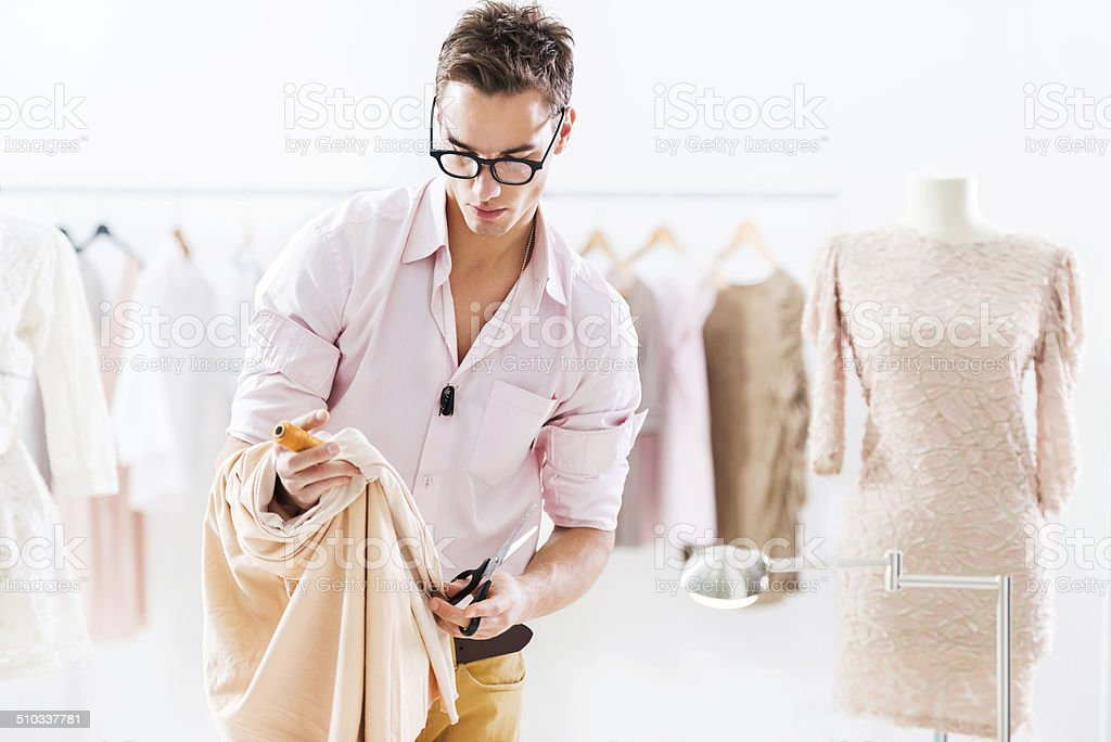 Young tailor at work. stock photo