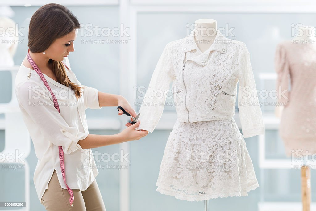Young tailor working in clothing design studio. stock photo