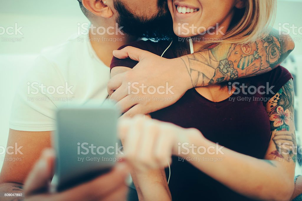 Young Tattooed Couple Making Selfie stock photo