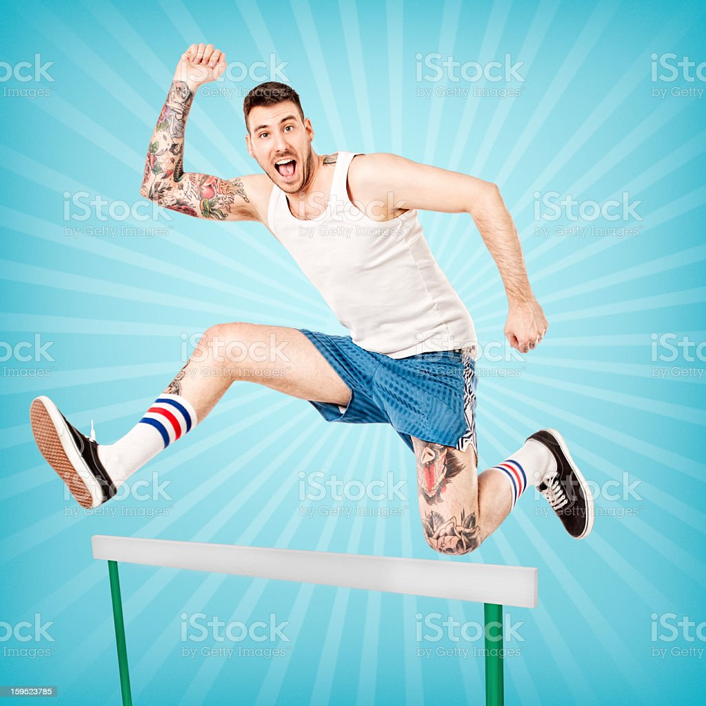 Young Tattooed Man Jumping stock photo