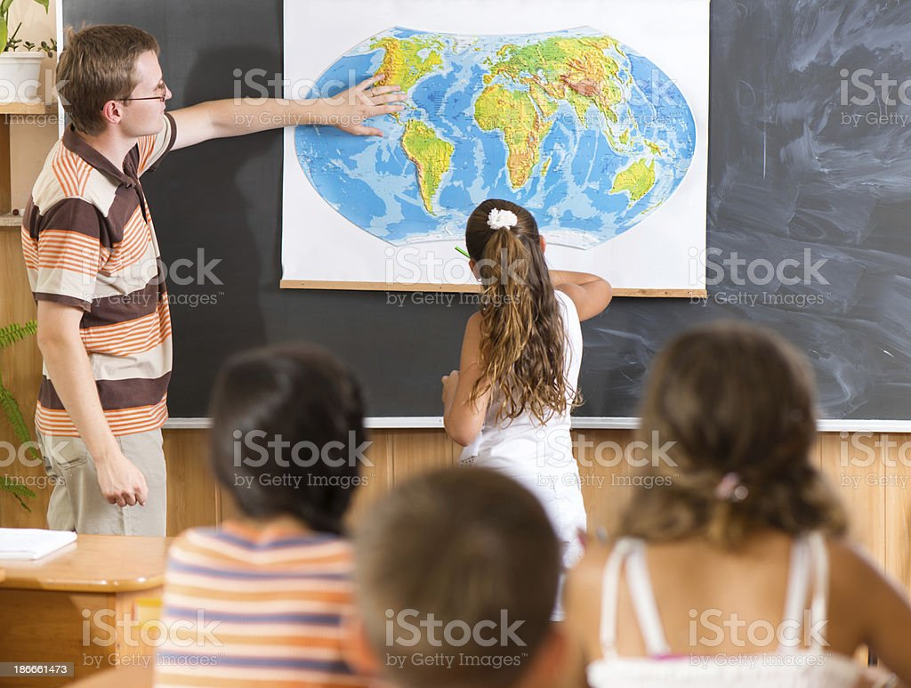 Young teacher at geography lesson stock photo