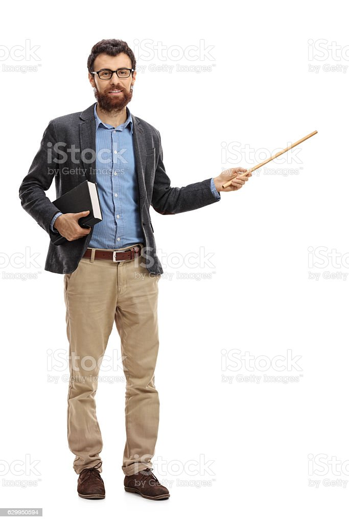 Young teacher holding a book and a wand stock photo