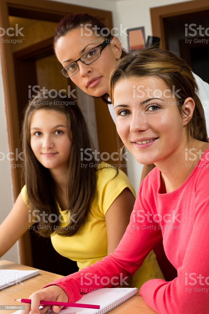 Young Teacher Working With Schoolgirls royalty-free stock photo