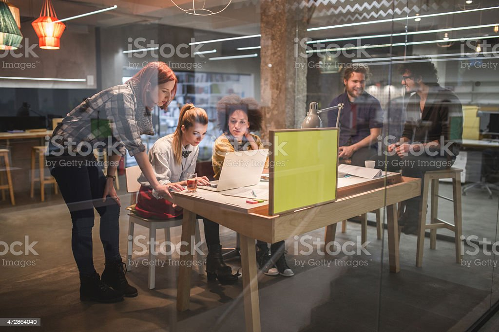 Young team of creative people working in office. stock photo