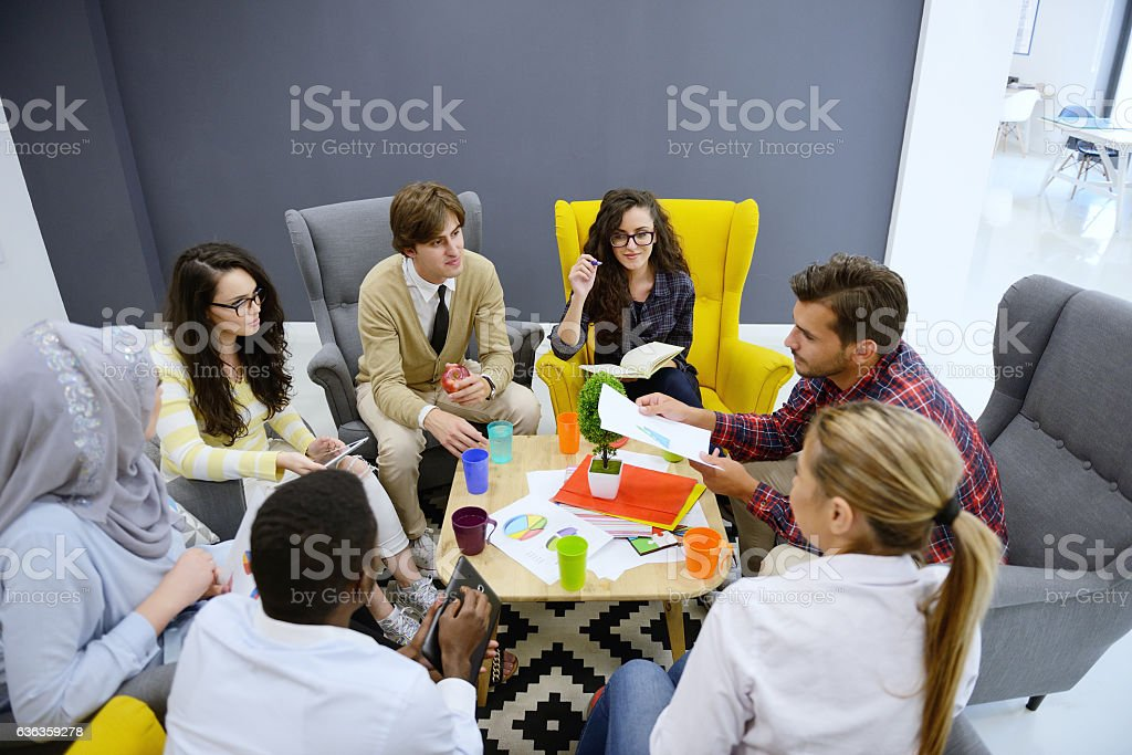 Young team of freelancers searching information making business tasks consulting stock photo