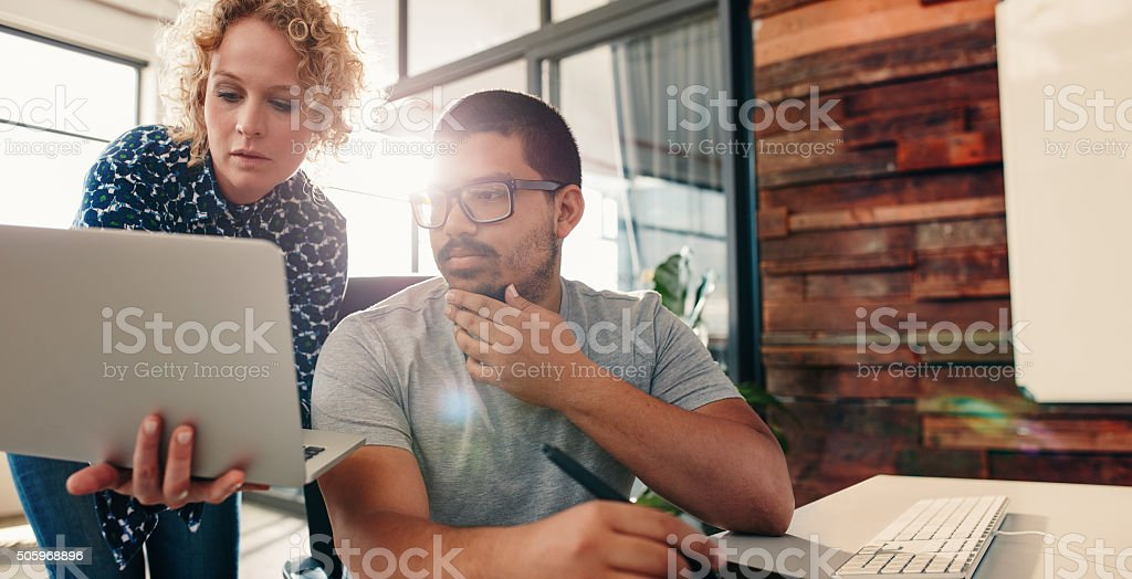 Young team of graphic designers working on new projects stock photo