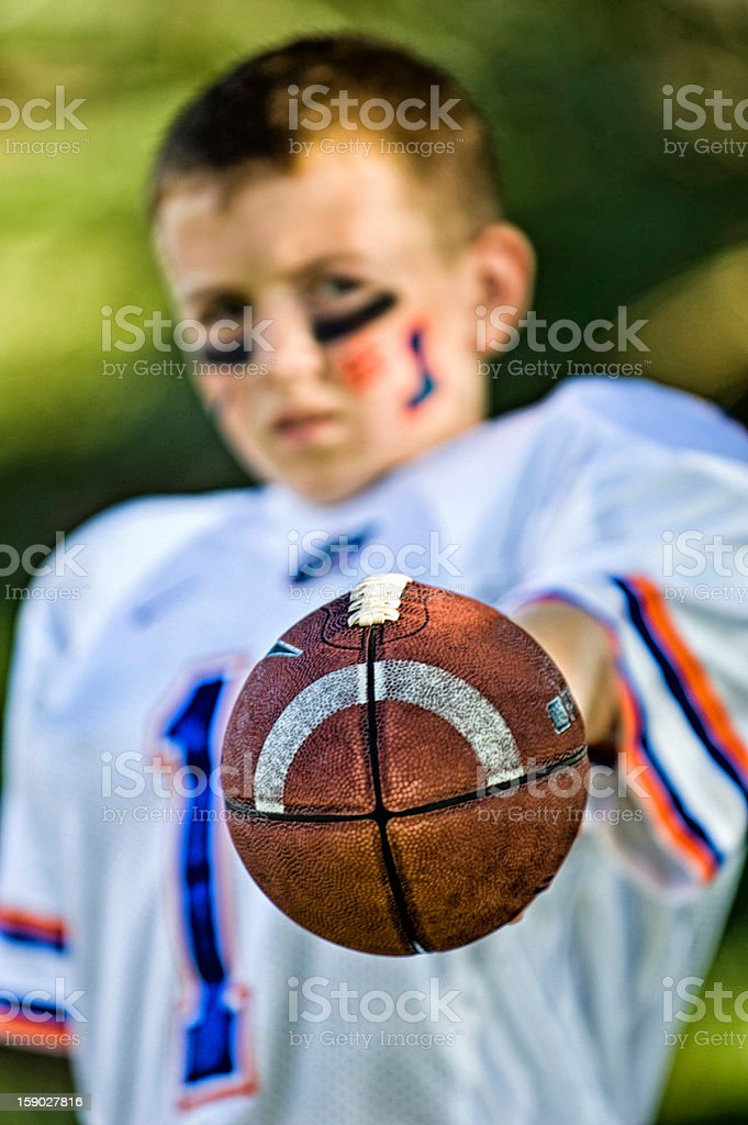 Young Team Player Holding Out Football royalty-free stock photo
