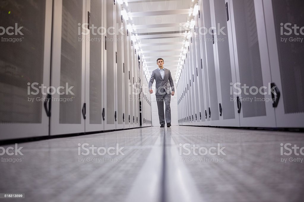 Young technician walking to the camera stock photo