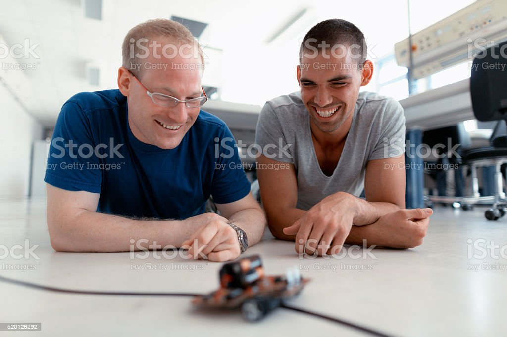 young technicians smiling stock photo
