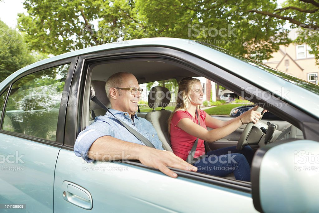Young Teen Driver Practicing Driving with Parent stock photo