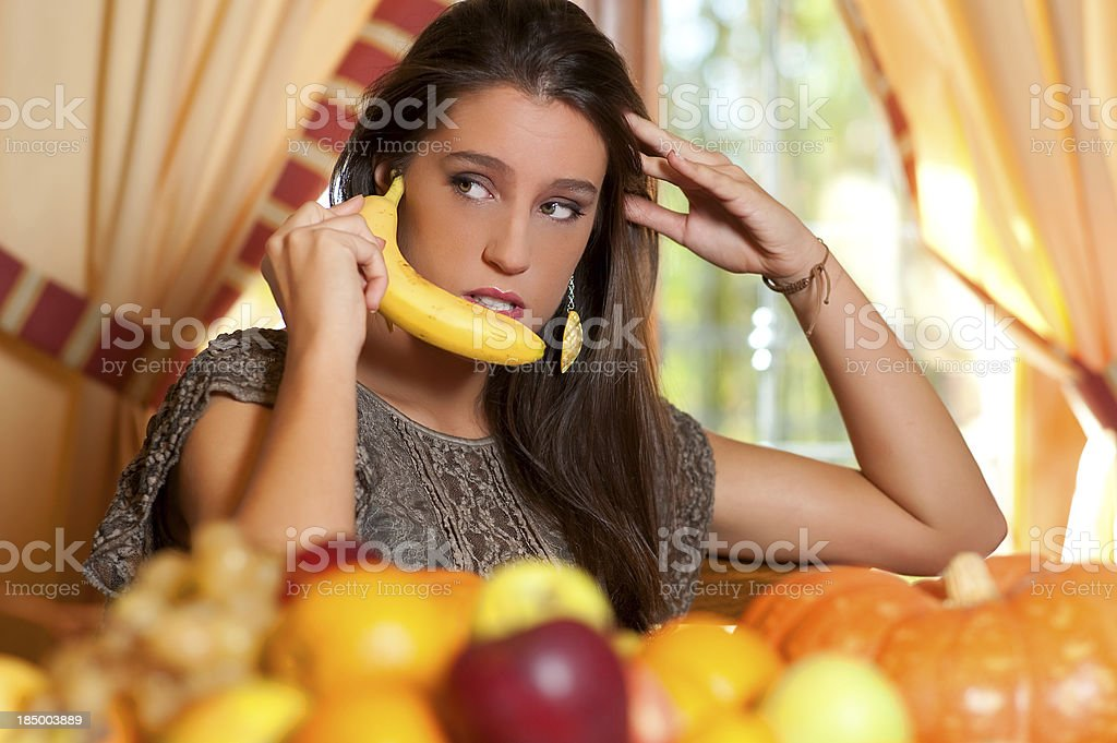 Young teen eats fruits on the living room table royalty-free stock photo