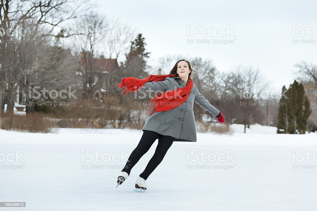 Young Teen Girl Figure Skater Enjoying Winter Outdoor Ice Rink royalty-free stock photo