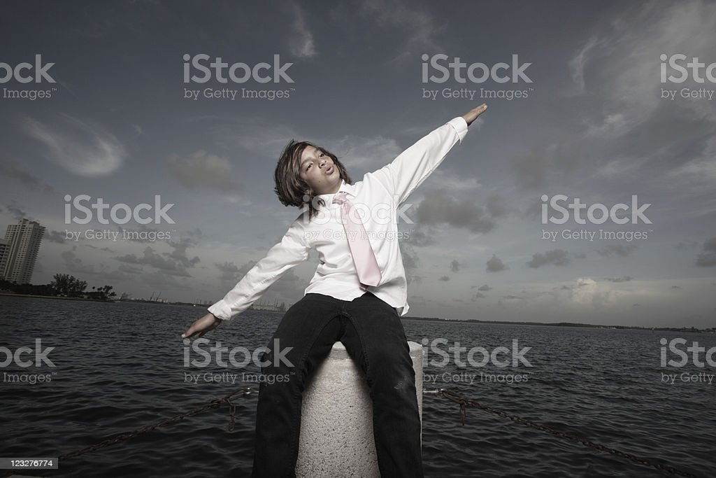 Young teen pretending to fly stock photo