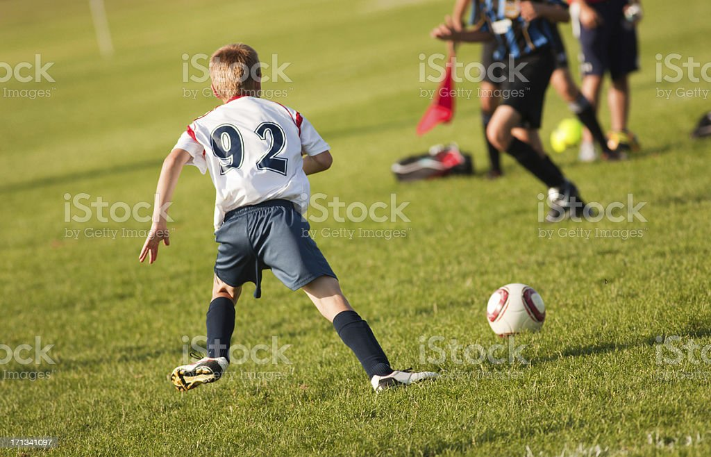 Young Teen Soccer Player in Competitive Game royalty-free stock photo