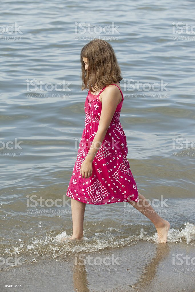 Young Teen Wadding Along the  Lakeshore. royalty-free stock photo
