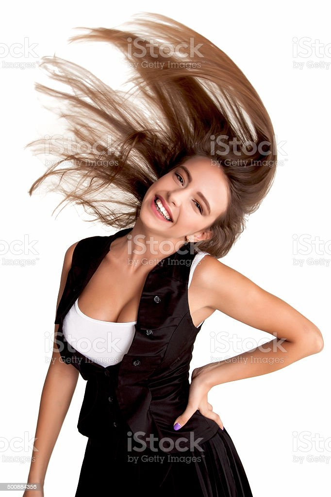 Young teen woman dancing and flowing hair in the air stock photo