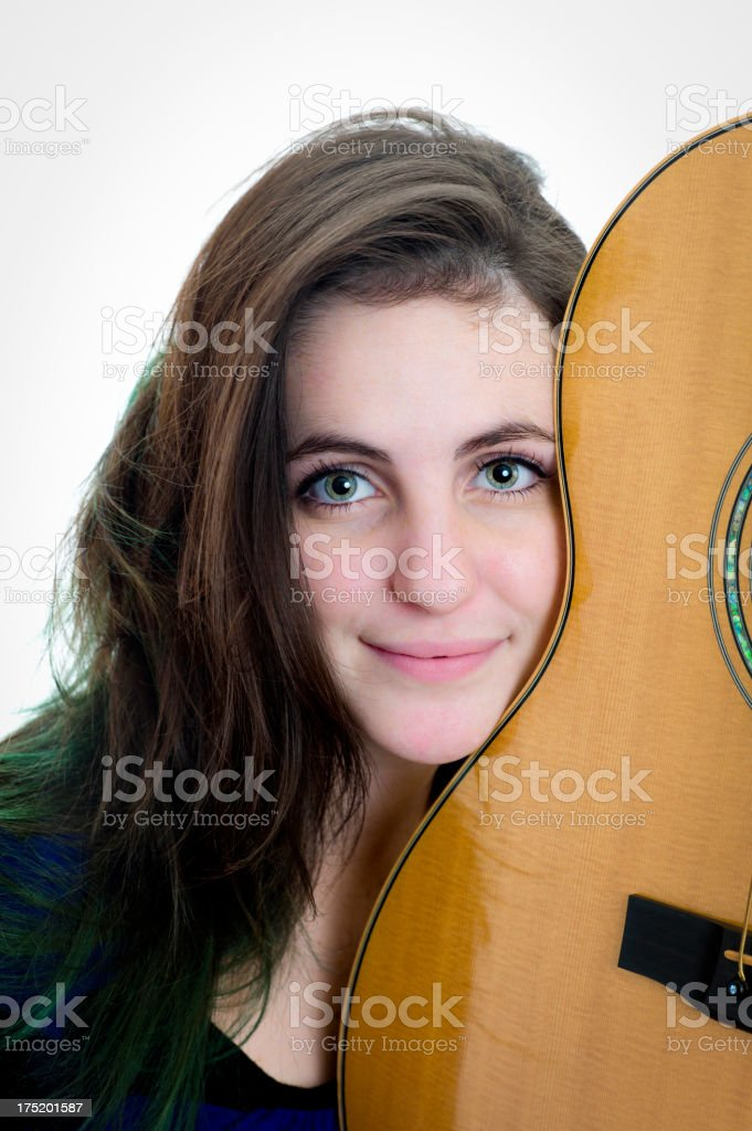 Young Teen Woman Hugging an Acoustic Guitar. royalty-free stock photo