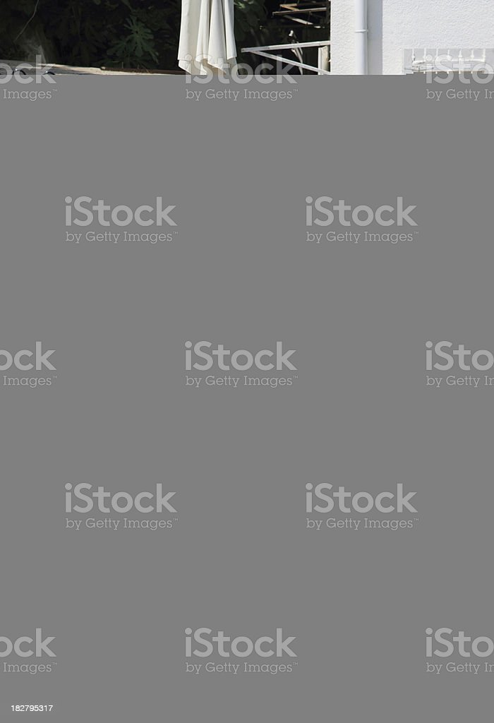 Young teenage boy holding books isolated on white. royalty-free stock photo