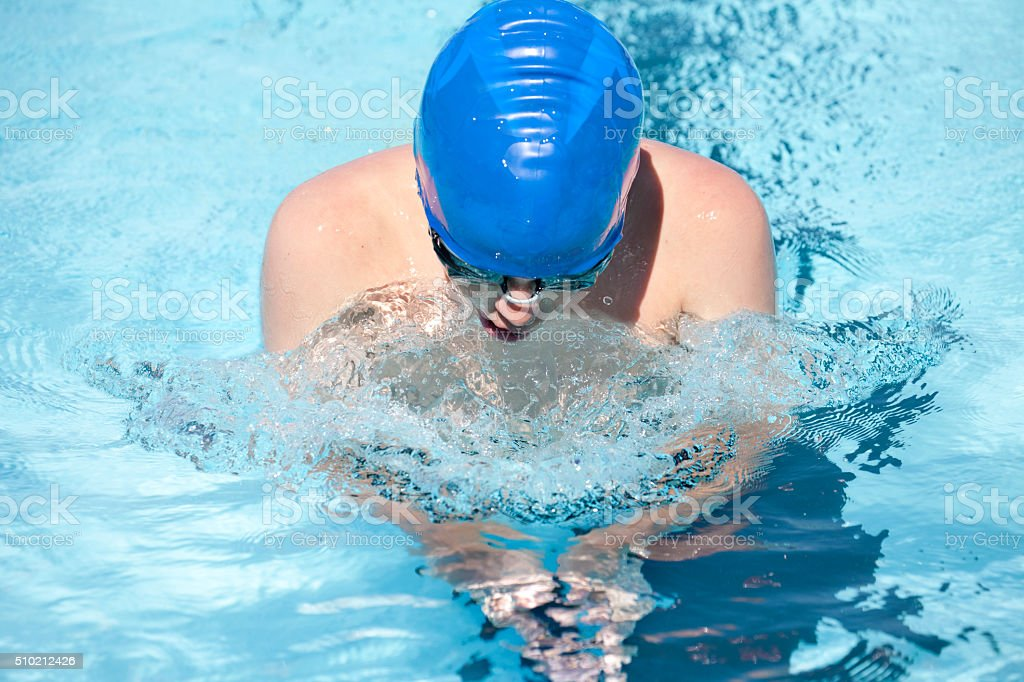 Young Teenage Boy Swimming Breaststroke Swim Stroke stock photo