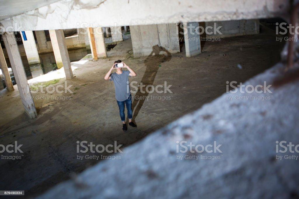Young teenage boy using virtual reality stock photo