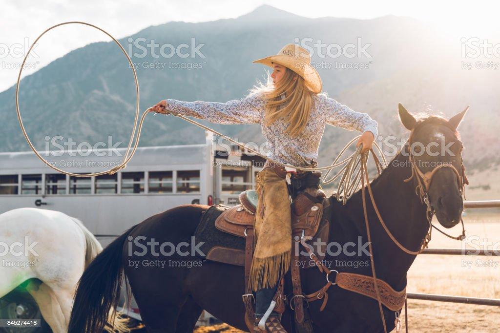 Young Teenage Cowgirl Lasso Training stock photo