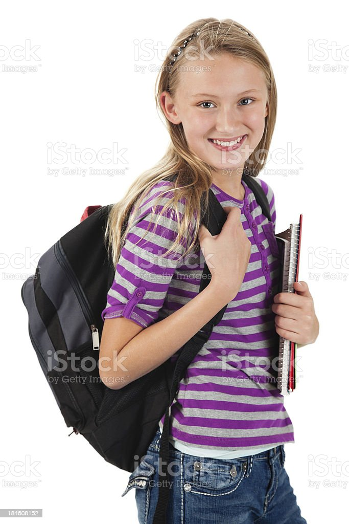 Young teenage girl carrying school supplies and backpack royalty-free stock photo
