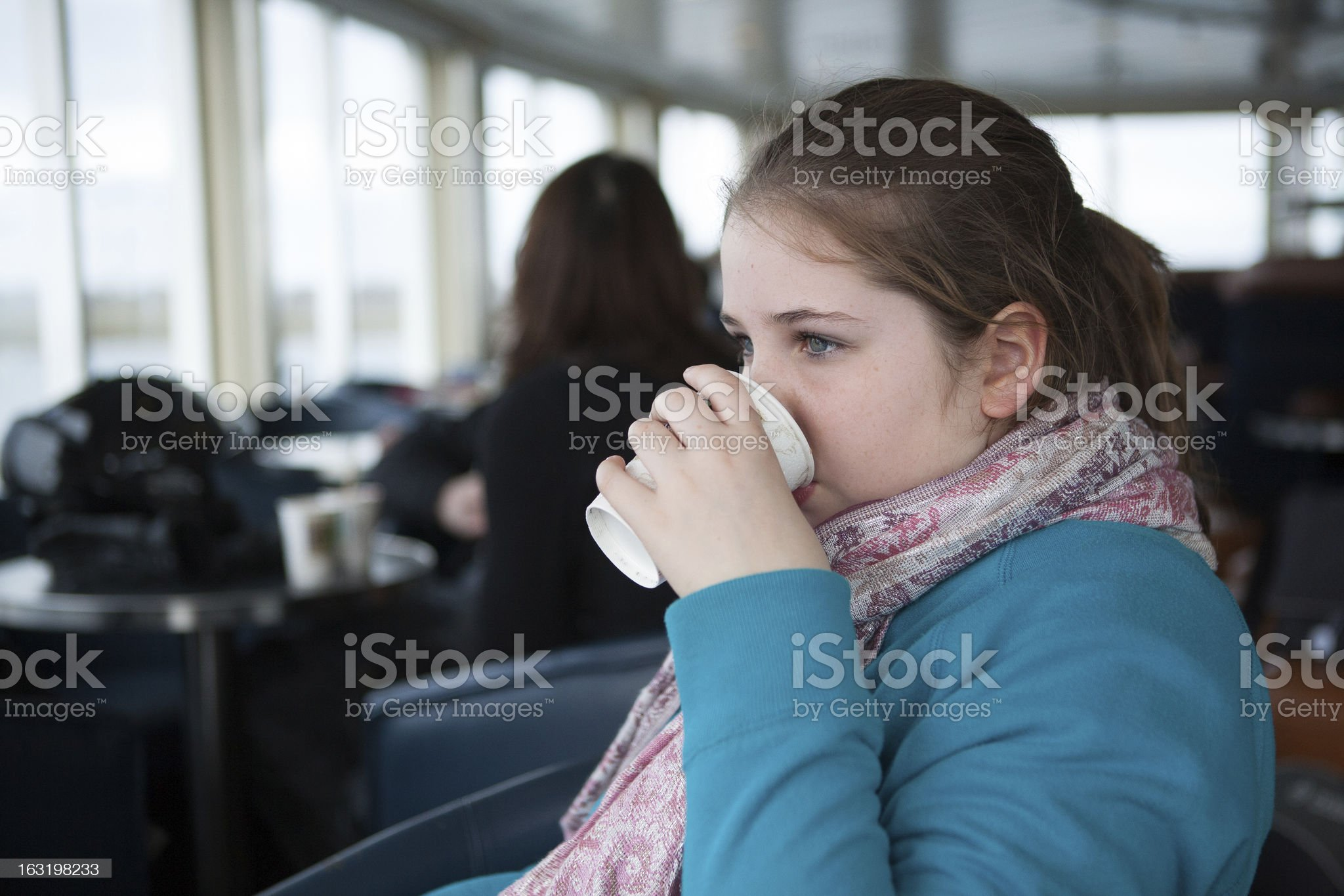 Young Teenage Girl Drinking From Paper Cup On a Ferry royalty-free stock photo