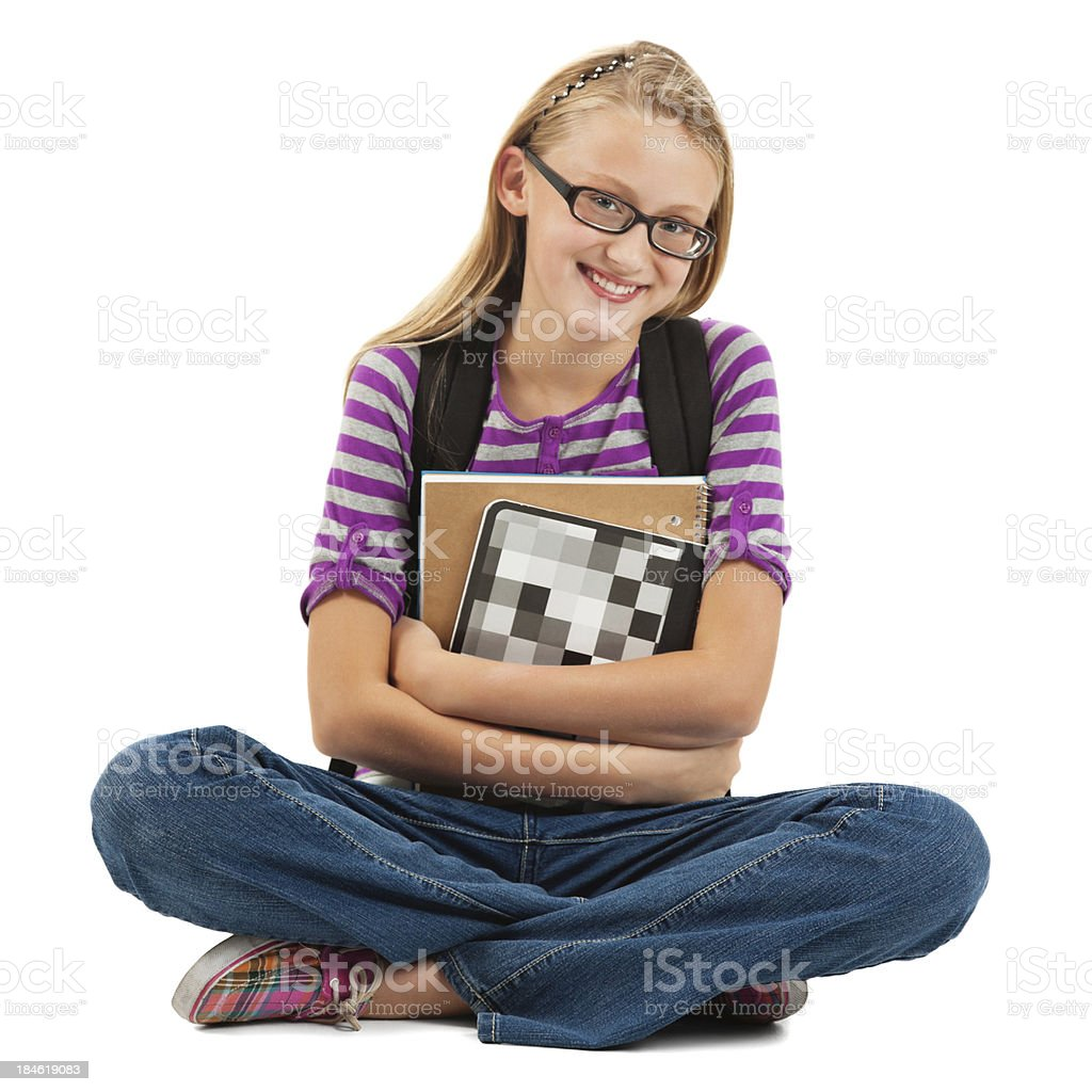 Young teenage girl sitting holding school supplies and backpack royalty-free stock photo