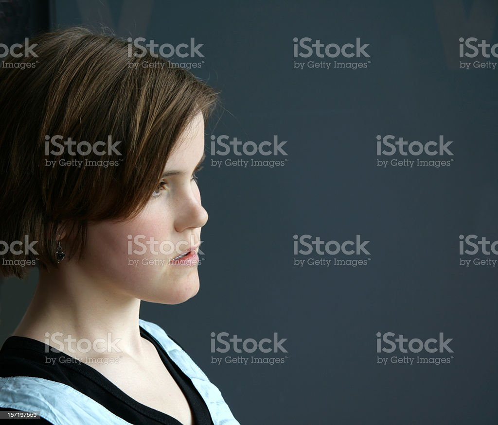 A young teenage girl with a pensive look on her face stock photo