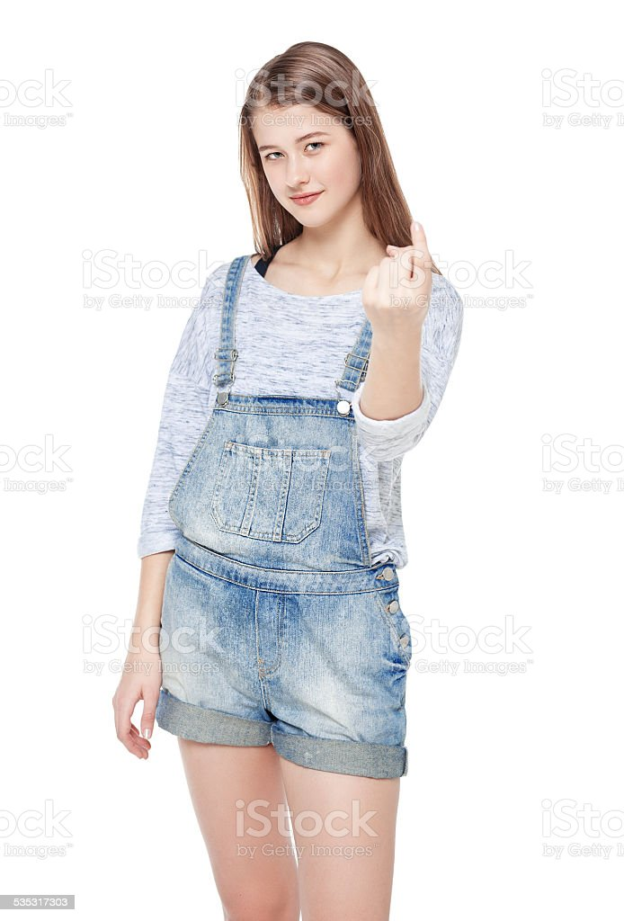 Young teenage girl with beckoning gesture isolated stock photo