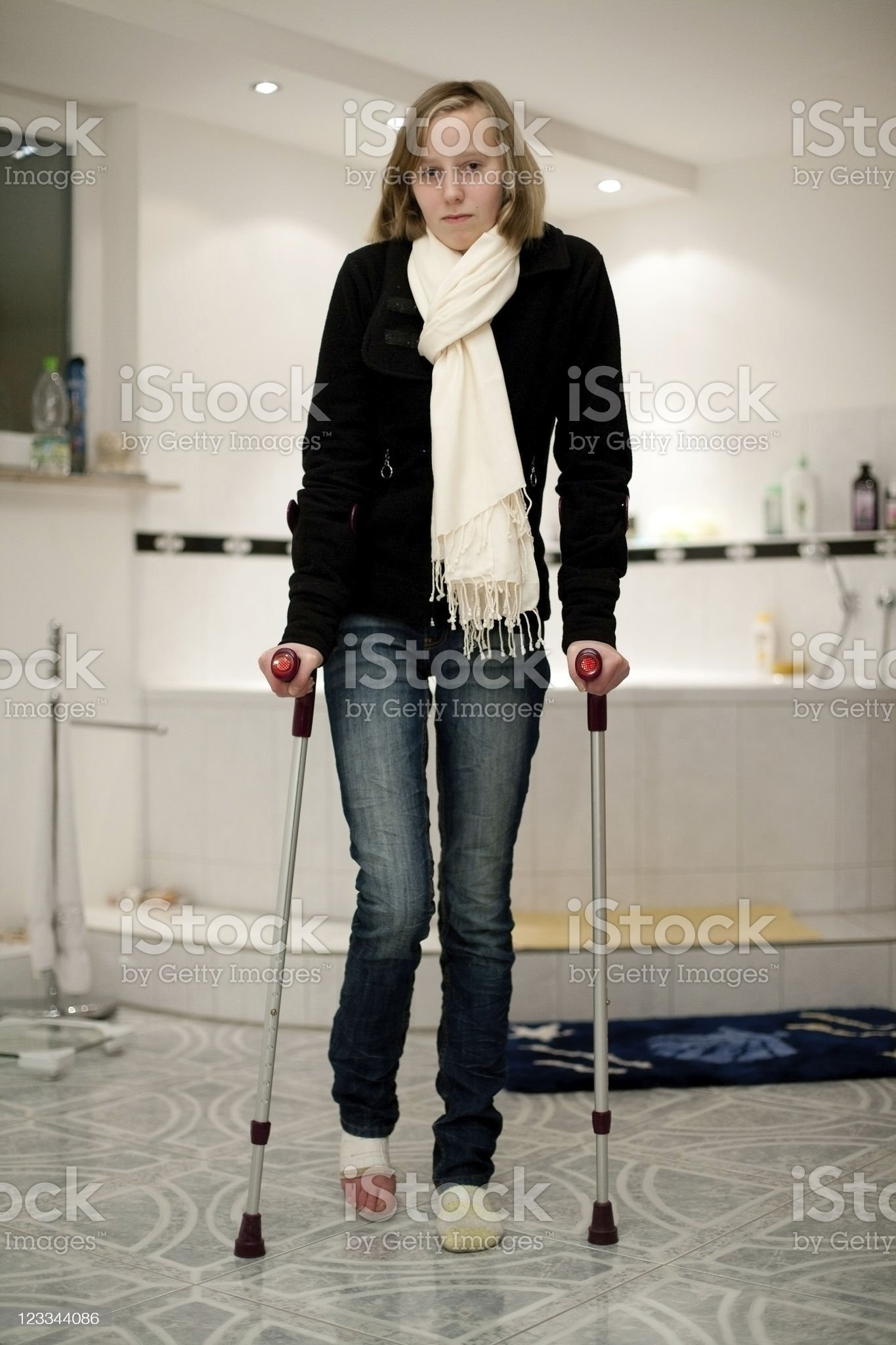 Young Teenage Girl With Crutches royalty-free stock photo