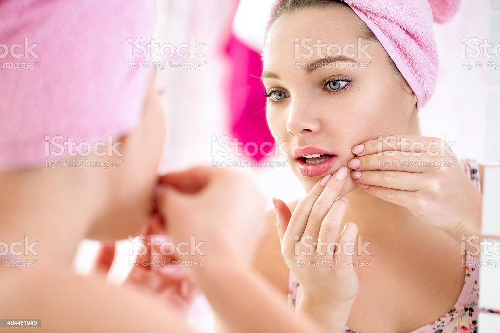 Young teenage girl  with pimple stock photo