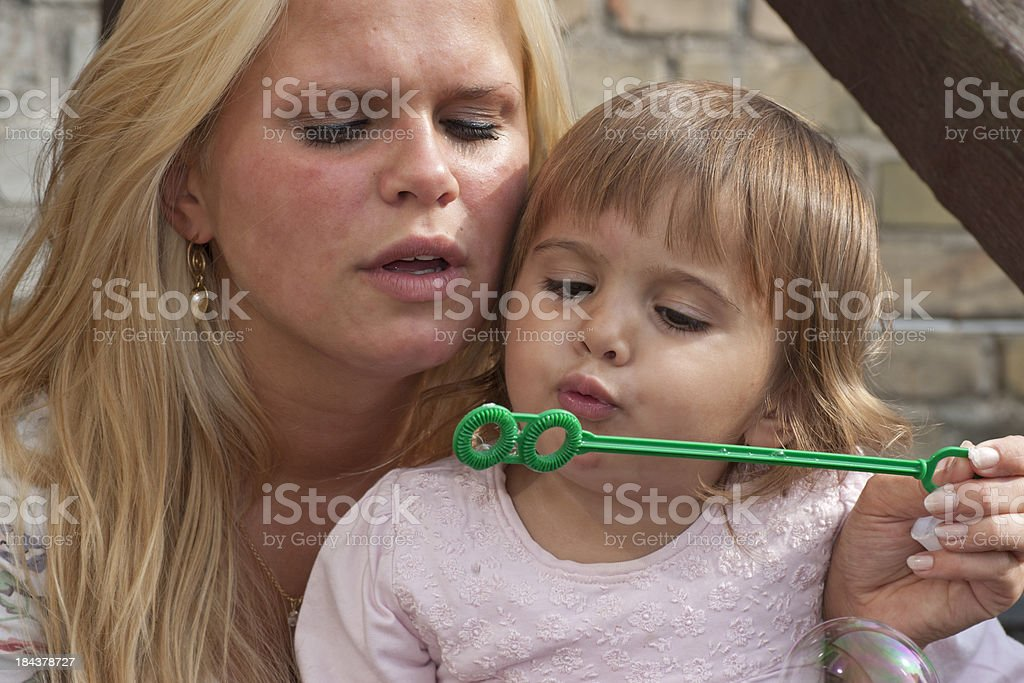 Young teenage mother with her child royalty-free stock photo