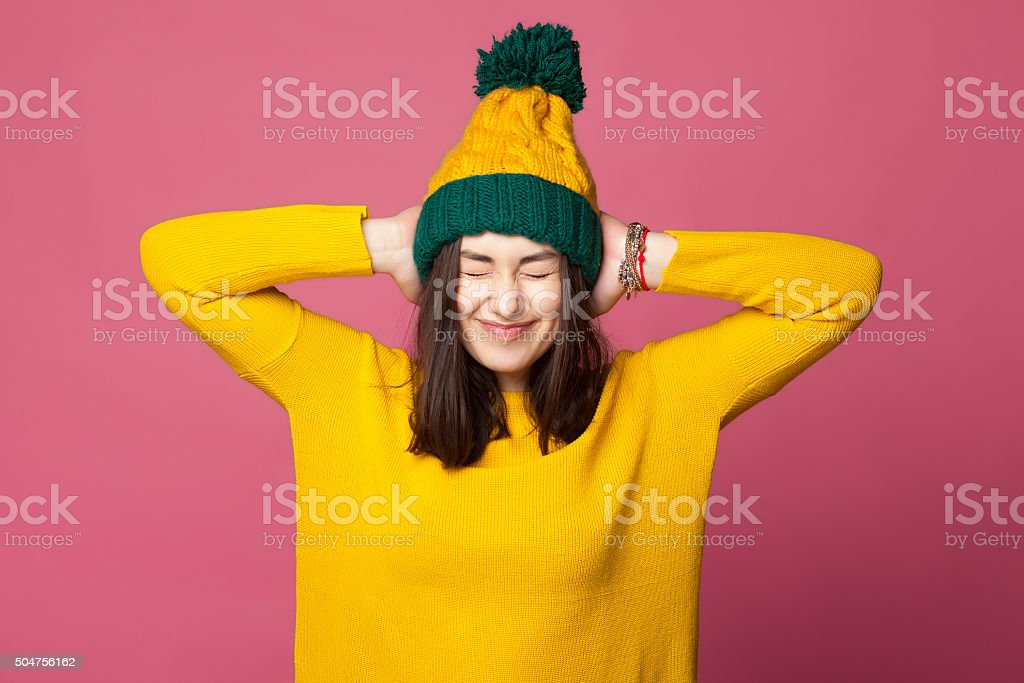 Young teenager girl closing ears stock photo