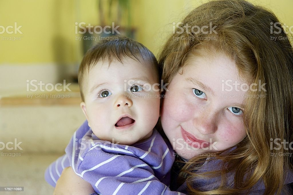 Young teenager holding baby royalty-free stock photo