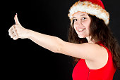 Young teenager in Christmas outfit with thumb up