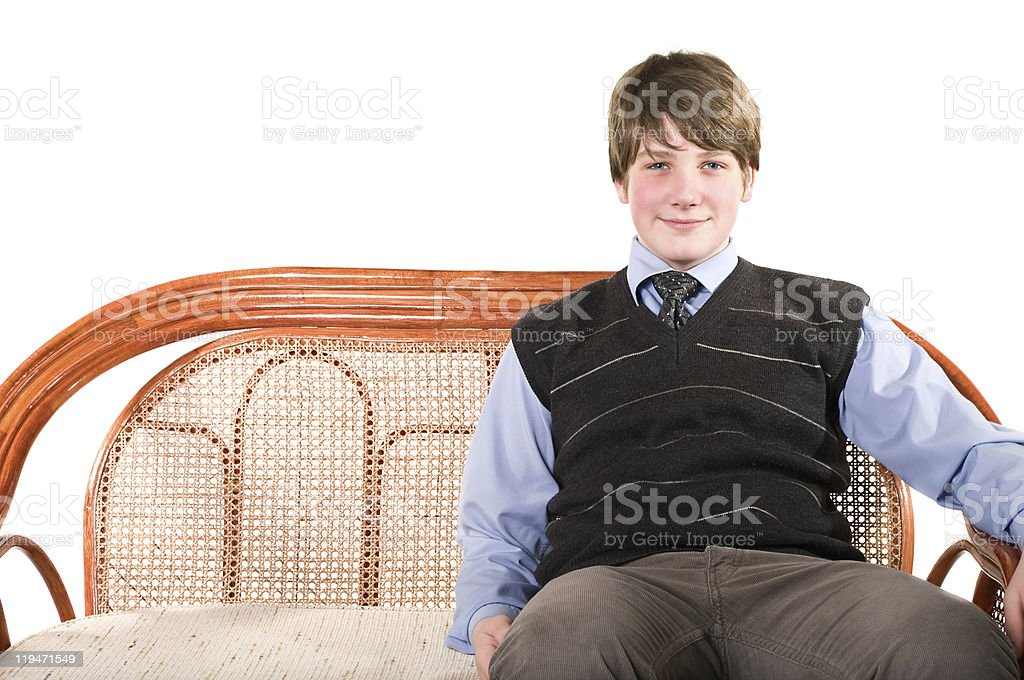 Young teenager on wicker sofa stock photo