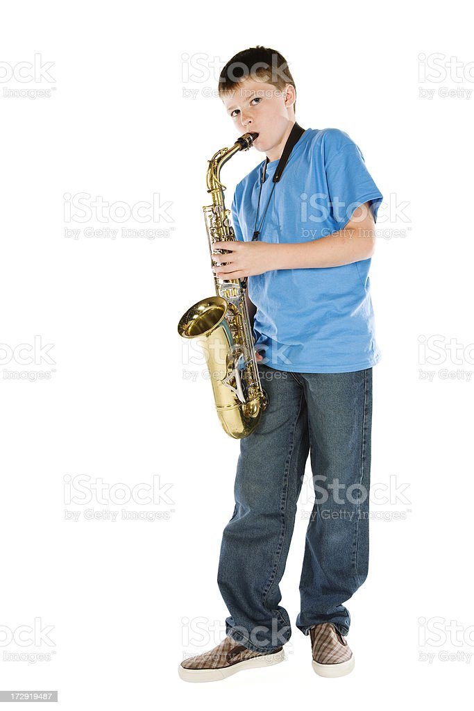 Young teenager practicing the saxophone stock photo