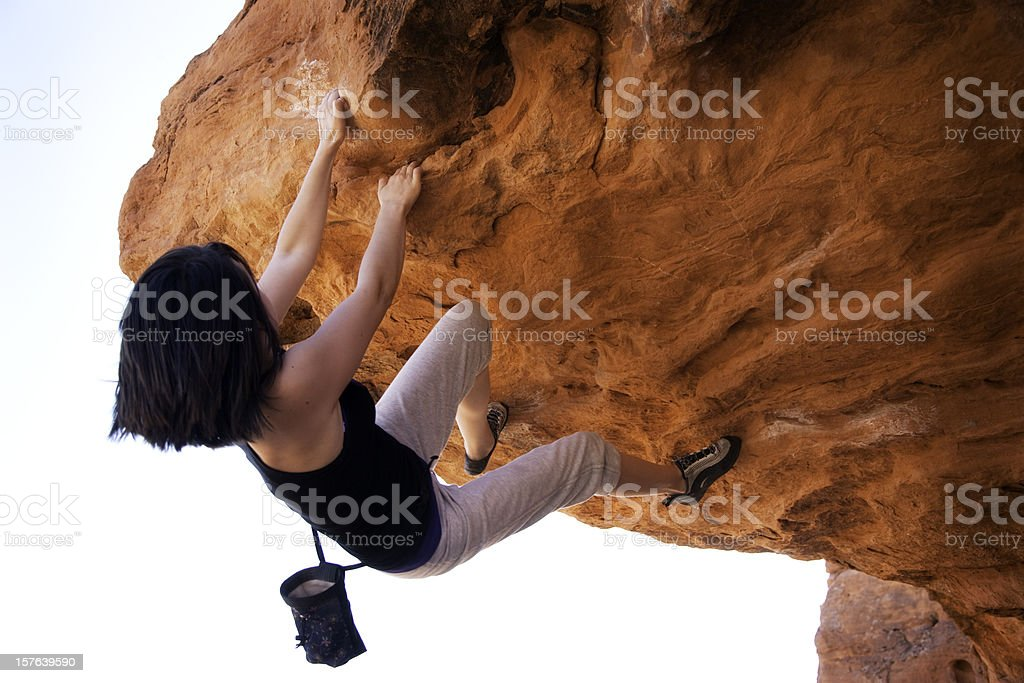 Young Teenager Rock Climbing in Red Rocks royalty-free stock photo