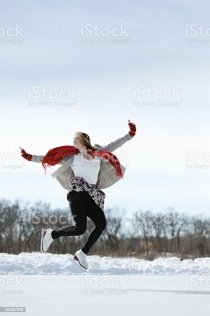 Young Teenager Skater Enjoying Skating on Outdoor Ice Rink Vt royalty-free stock photo