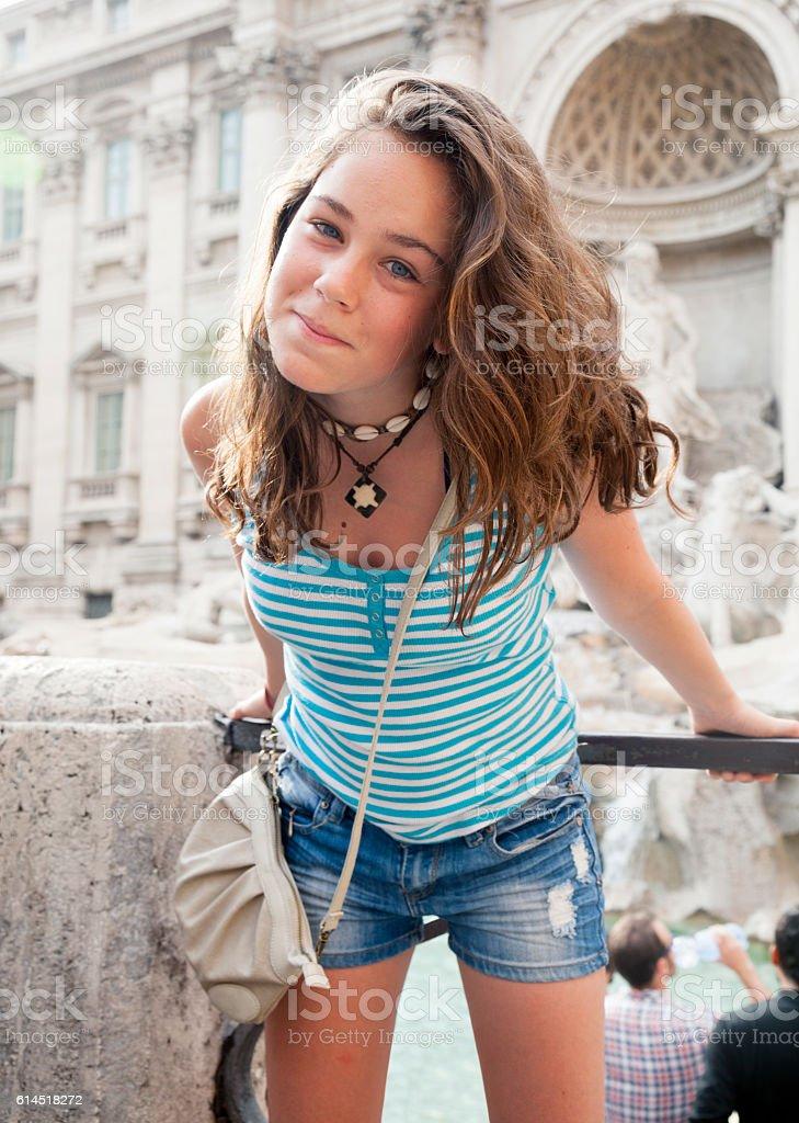 Young teenager tourist at the Fontana de Trevi stock photo