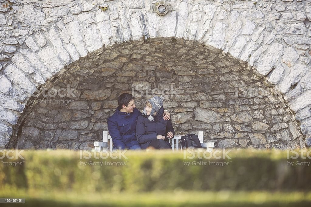 Young teens flirting hiding in the park stock photo