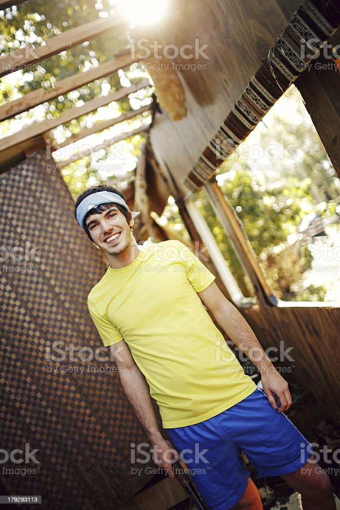 Young Tennis Guy in Yellow Outdoors royalty-free stock photo