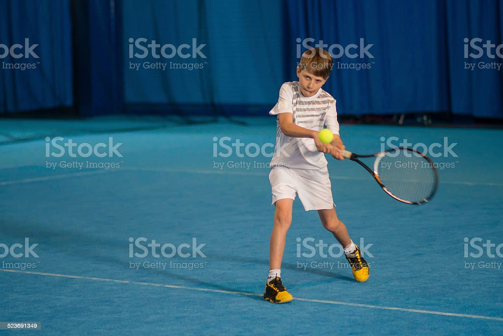 Young Tennis Player Practicing Indoors stock photo