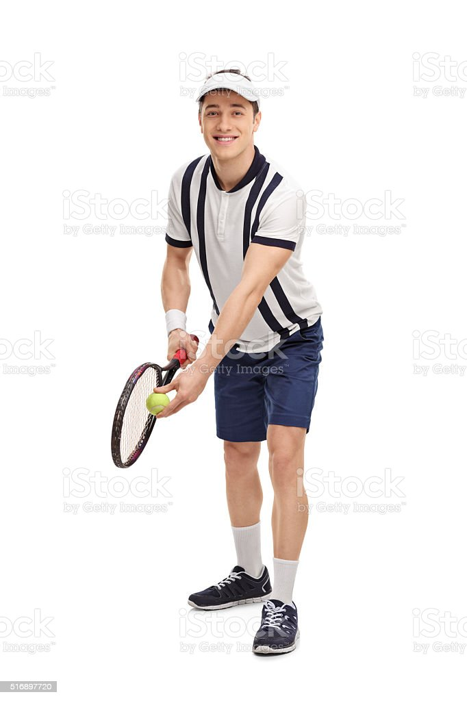 Young tennis player preparing for a serve stock photo