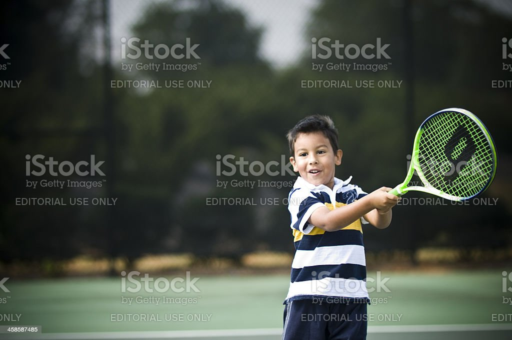 young tennis player swings stock photo