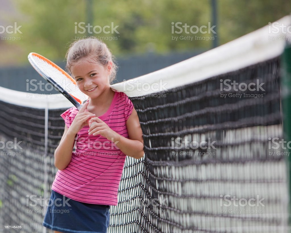 Young Tennis Player takes a Break royalty-free stock photo