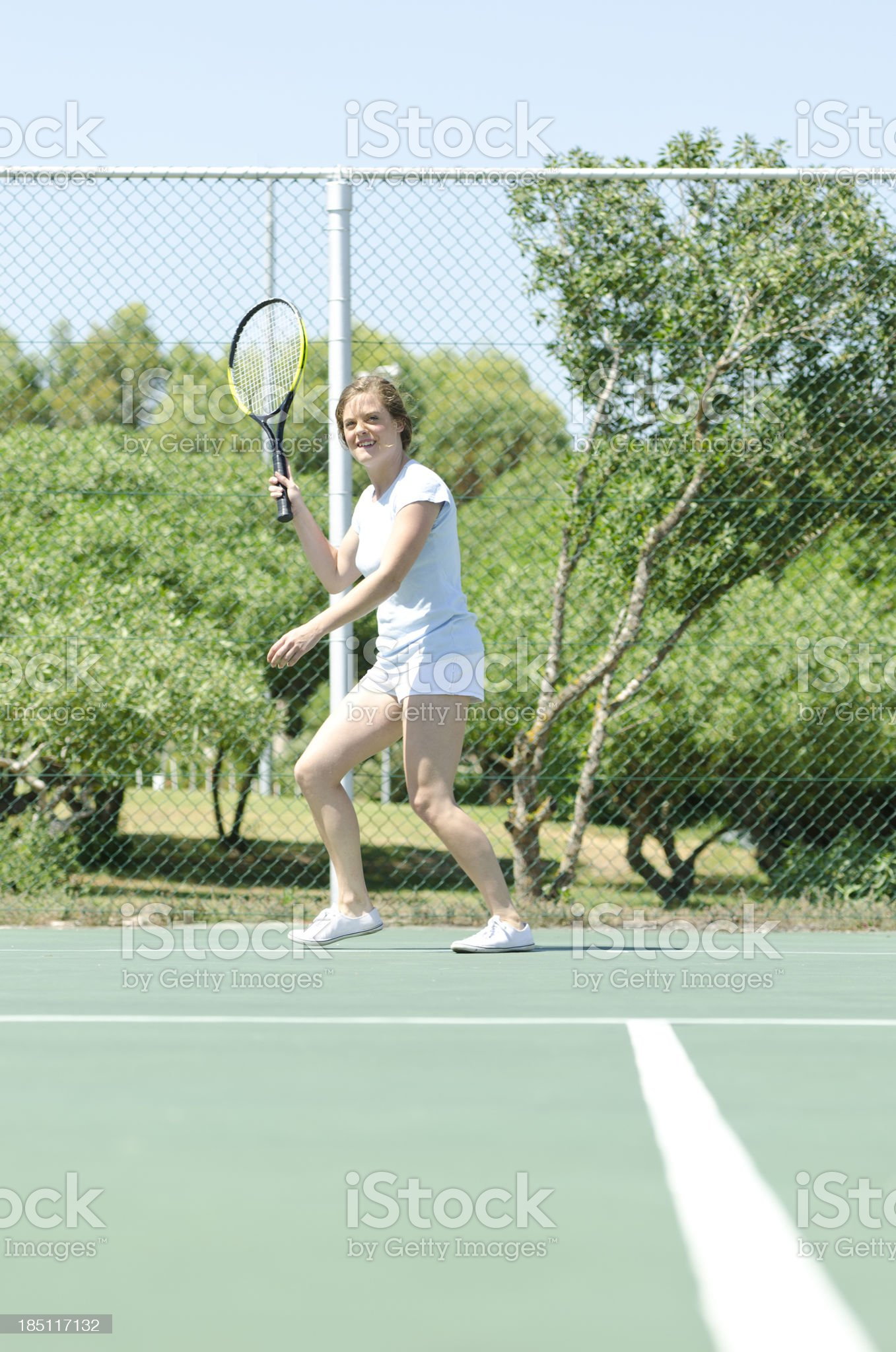 Young tennis player waiting the ball royalty-free stock photo